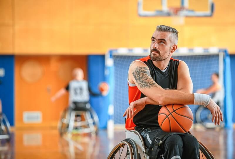 Male Wheelchair Basketball Player Holding Ball